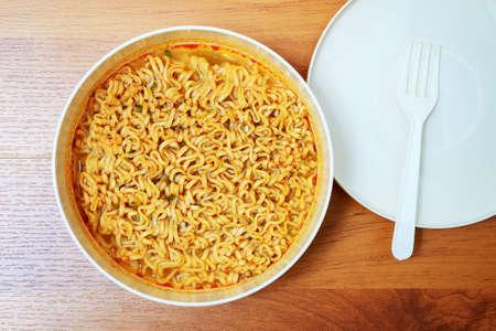 Instant noodles on wood baord