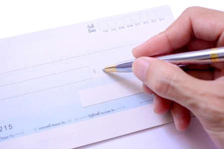 pay check: Writing a check Stock Photo