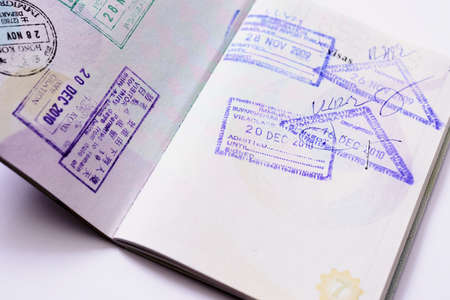 globetrotter: Immigration arrival stamps on passport Stock Photo