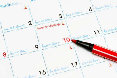 organizer page: Calendar with pen pointing at 10