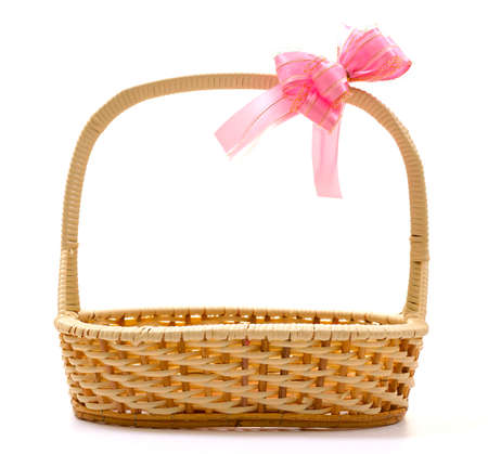 Empty wicker basket with bow isolated on white background photo