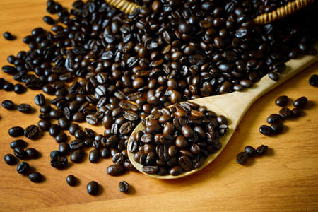 Coffee beans on wooden board