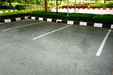 parking space: Empty space in a parking lot Stock Photo