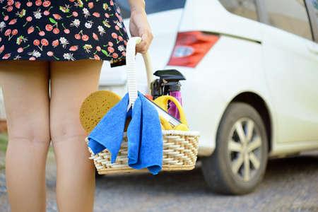 Woman ready for washing a car