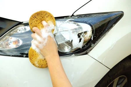 headlights: Washing a car Stock Photo