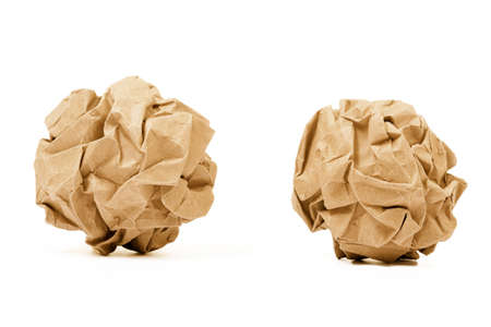 crinkled: Crumpled brown paper ball isolated on white background