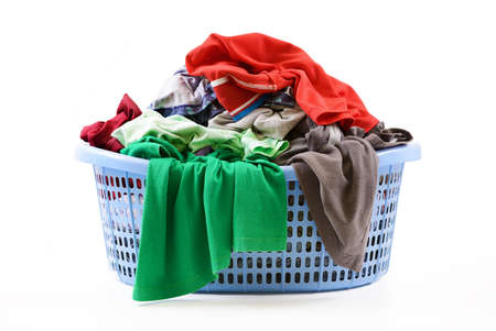 laundry pile: Clothes in a laundry basket isolated on white background