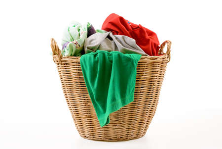 dirty clothes: Clothes in a laundry wooden basket isolated on white background Stock Photo
