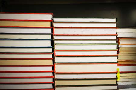 Stack of old books in shelf