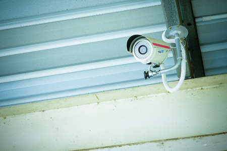 CCTV security camera under the roof Standard-Bild