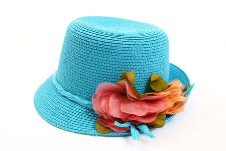 Pretty straw hat with flower on white background