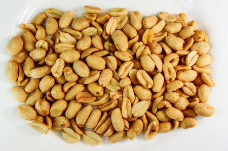 peanut. peanuts on a white background. roasted fragrant delicious grains of peanuts with seasoning Reklamní fotografie