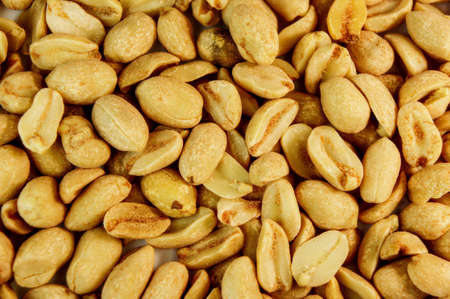 peanut. peanuts close up. roasted fragrant delicious salted grains of peanuts with seasoning