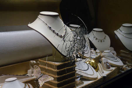 insurance themes: Broken Glass jewelry store gold, Brilliant, outdoors