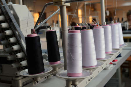 garment industry: Garment industry, sewing machine, needle and thread, warehouse, manufacturing products Stock Photo