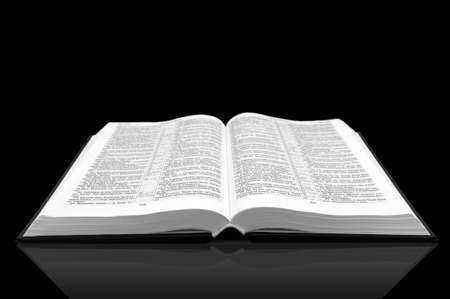 phenomenon: Open book bible on black background with shadow