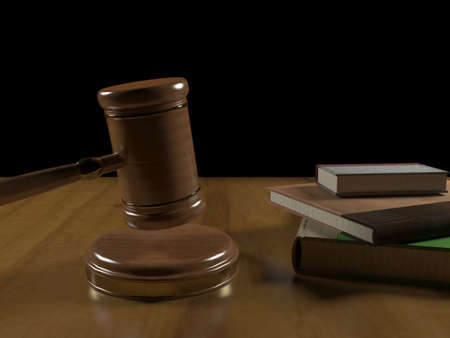 legality: Gavel and books on the judges desk