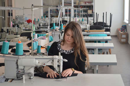 Seamstress in a garment factory Stock Photo