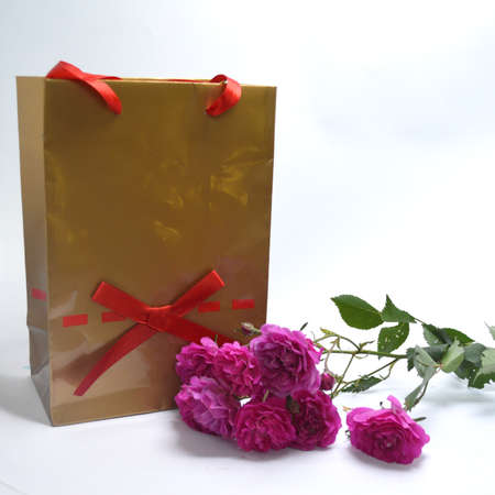 pleasantness: Gift package with flowers