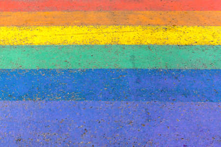 Crossing in street of LGBTQI or LGBT rainbow pride flag colors as colorful background, copy space. Vilnius, Lithuania.