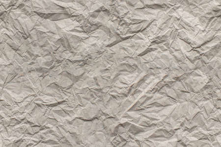 Seamless background of beige creased paper, vintage wrinkled paper texture, copy space