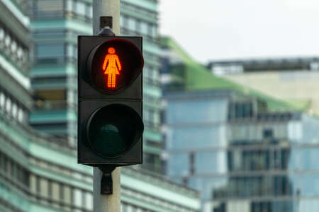 Red pedestrian signal. Traffic light female figure shape in one of avenue in Vilnius, Lithuania