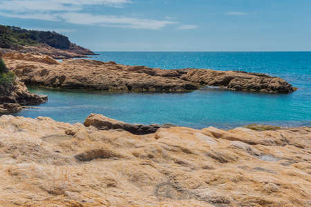 Rocky beach landscape of Costa Brava. Extraordinary rock formations in turquoise sea.Lloret de Mar. Catalonia. Spain.