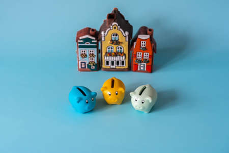 Piggy banks for saving in front of house models