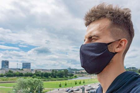 Man wearing protective mask for coronavirus in urban surroundings