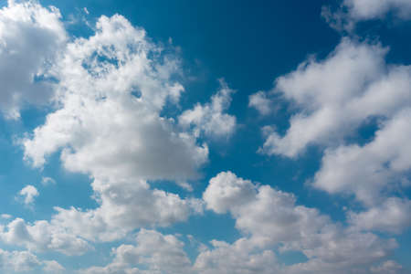 Blue sky with clouds like cotton. Blue sky and white clouds background. Heavenly scenery. Meteorology. Forecast. Stockfoto