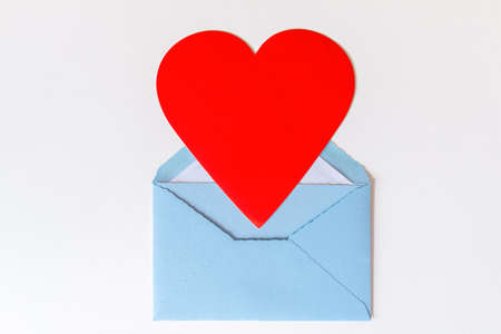 Open blue envelope with big red heart on white background. Love letter with heart. Gratitude to doctors and nurses. Valentine's, Mother, Women's day greetings.