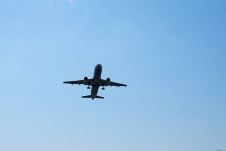 Airplane take off at airport. Passenger plane fly up over take-off runway from airport.