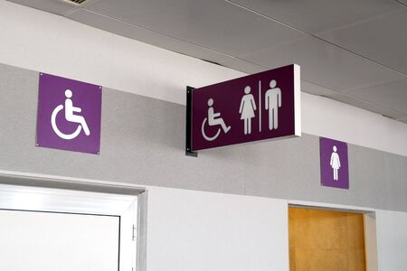 Public restroom signs with a disabled access symbol. Toilets sign panels.