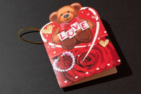 Greeting card with the inscription love and a teddy bear. Valentines Day Stok Fotoğraf