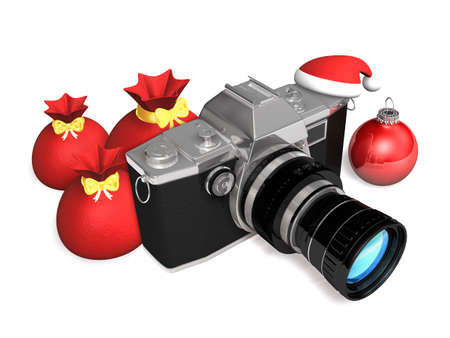 one camera and three christmas gift sack Stock Photo