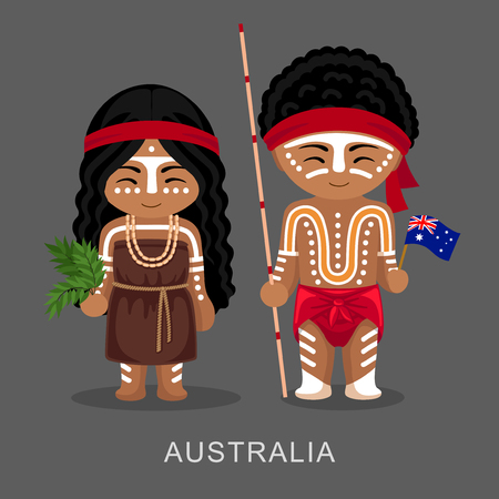 Australian aborigines in national dress with a flag.