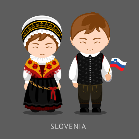 Slovenes in national dress with a flag.