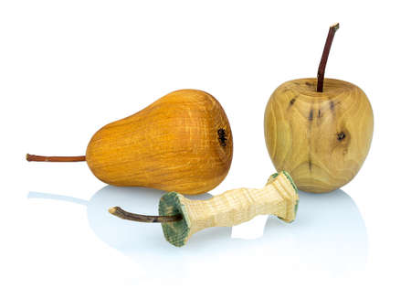 Wooden apple, apple stub and pear  made from a different types of wood isolated on white background with shadow reflection. Perfect arranged handcrafted decorative fruits on white underlay.