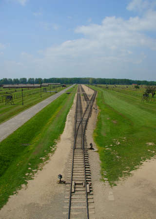 Rail entrance to concentration camp at Auschwitz II - Birkenau. View from the gate guard tower to train arrival point of former Nazi concentration and extermination camp near Oswiecim city, Poland.