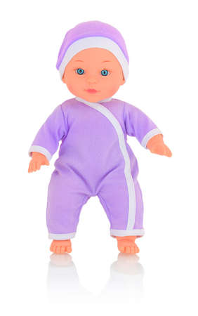 Baby doll wearing purple bodysuit and cap isolated on white background with shadow reflection. Caucasian new-born child toy wearing violet clothes for newborns. Infant cuddly pink toy doll. 版權商用圖片