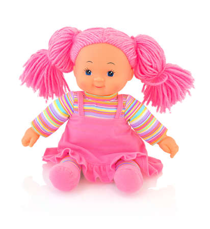 Pinky plushie doll isolated on white background with shadow reflection. Cute pinky rag baby doll sitting on white underlay. Nice contemporary rag baby with pink hair. Modern joyfully rag baby. Stok Fotoğraf