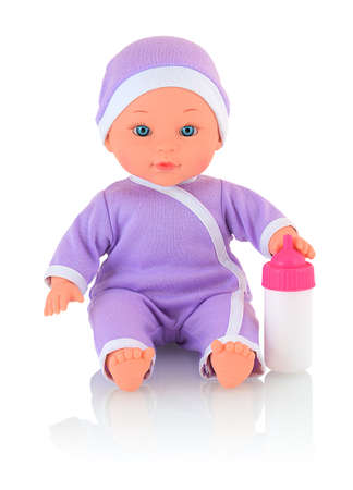 Baby doll wearing bodysuit and cap, with bottle of milk isolated on white background with shadow reflection. Caucasian new-born child toy wearing violet clothes for newborns. Infant cuddly toy doll.
