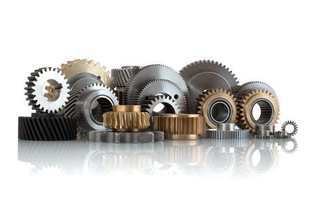 Sets of gears, cogwheels made of steel and brass isolated on white background with shadow reflection. Helical and spur gears,some with bearing isolated on white background with shadow reflection. Stock Photo