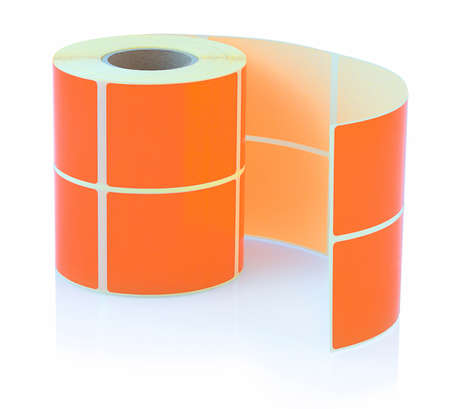 Orange label roll isolated on white background with shadow reflection. Color reel of labels for printers. Labels for direct thermal or thermal transfer printing. 版權商用圖片