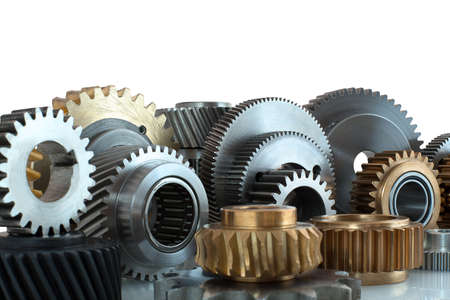Sets of gears, cogwheels made of steel and brass isolated on white background with shadow reflection. Helical and spur gears,some with bearing isolated on white background with shadow reflection. 版權商用圖片
