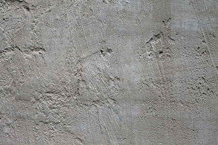 Smooth concrete texture. Beton uneven texture. Photographic pattern. Cement concrete surface. Creme gray rabblework superficies. Concrete superficial area. Concrete wallpaper, background image.