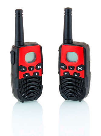 Red and black walkie talkie isolated on white background with shadow reflection. Portable radio transmitter. Radio transceiver on white backdrop. Handheld communication radio.