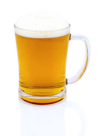 Mug of beer with foam isolated on white background with shadow reflection. Half a liter of beer in glass on white backdrop. Ale in bock. A pint of beer.