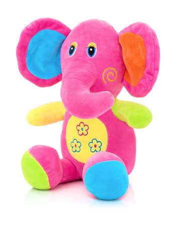 Elephant plushie doll isolated on white background with shadow reflection. Elephant plush stuffed puppet on white backdrop. Jumbo plushie toy. Rainbow colored stuffed elephant toy. Pinky elephant. 版權商用圖片