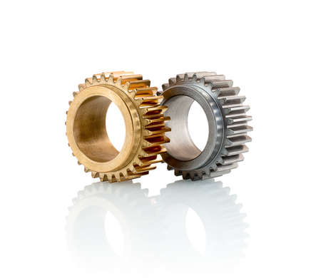 Sets of gears, cogwheels made of steel and brass isolated on white background with shadow reflection. Spur gears isolated on white background with shadow reflection.